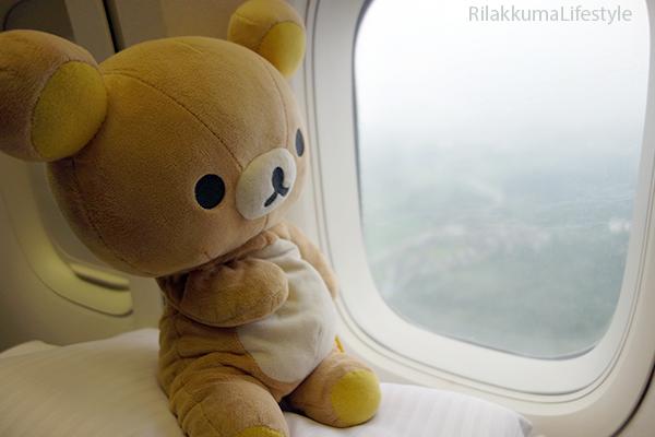 Rilakkuma on Airplane - window view
